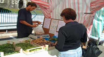 Pandy farm stall holder serving customer